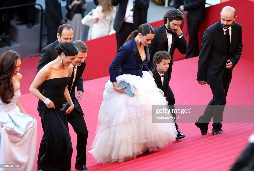 Actresses Pauline Burlet and Sabrina Ouazanim, producer Alexandre Mallet-Guy, director Asghar Farhad (behind), actress Berenice Bejo and actors Elyes Aguis, Tahar Rahim and Ali Mosaffa attend the Premiere of 'Le Passe' (The Past) during The 66th Annual Cannes Film Festival at Palais des Festivals on May 17, 2013 in Cannes, France.