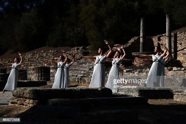 TOPSHOT Actresses perform at the Temple of Hera on October 22 2017 during a dressed rehearsal of the lighting ceremony of the Olympic flame in...