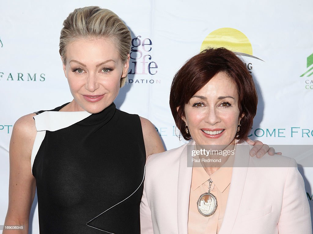 Actresses <a gi-track='captionPersonalityLinkClicked' href=/galleries/search?phrase=Portia+de+Rossi&family=editorial&specificpeople=204197 ng-click='$event.stopPropagation()'>Portia de Rossi</a> and <a gi-track='captionPersonalityLinkClicked' href=/galleries/search?phrase=Patricia+Heaton&family=editorial&specificpeople=173459 ng-click='$event.stopPropagation()'>Patricia Heaton</a> arrive at the 6th Annual Compton Jr. Posse Gala at Los Angeles Equestrian Center on May 18, 2013 in Los Angeles, California.