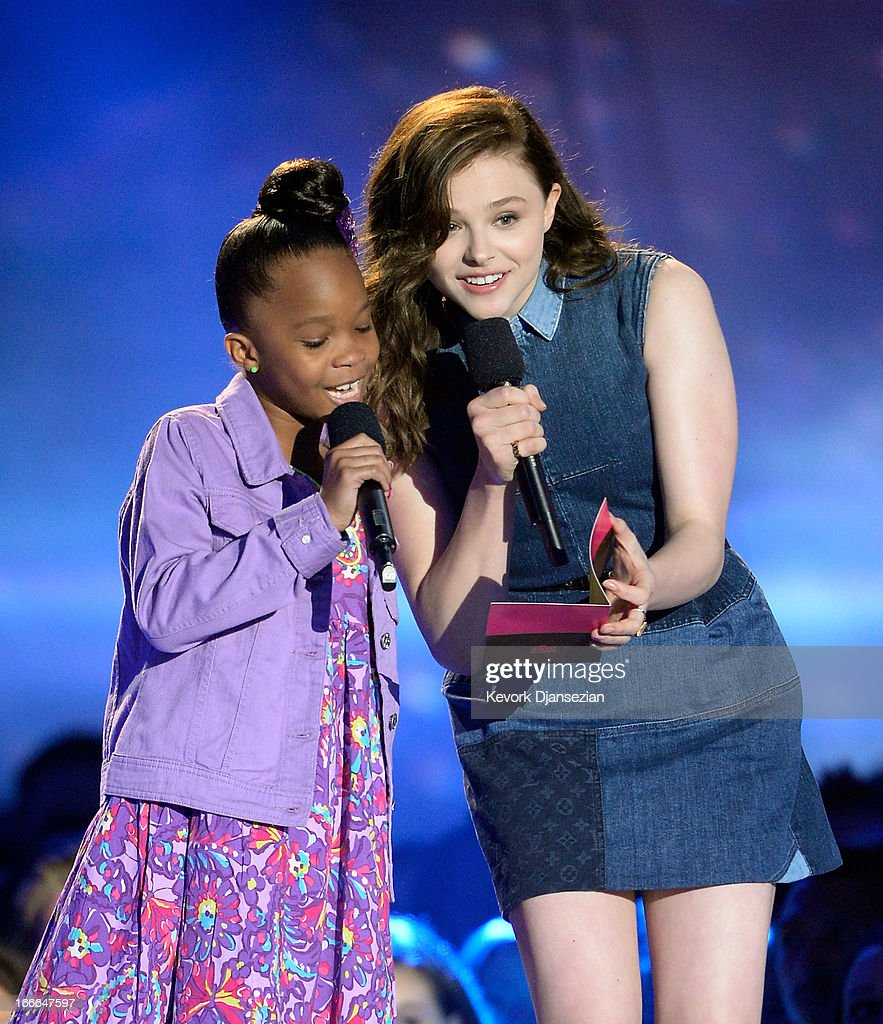 Actresses Quvenzhane Wallis (L) and Chloe Grace Moretz speak onstage during the 2013 MTV Movie Awards at Sony Pictures Studios on April 14, 2013 in Culver City, California.