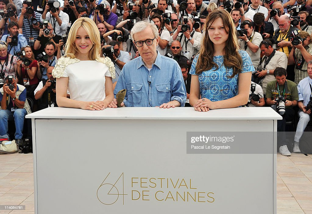 Actresses Rachel McAdams (left) and Lea Seydoux (right) with director Woody Allen attend the 'Midnight In Paris' photocall at the Palais des Festivals during the 64th Cannes Film Festival on May 11, 2011 in Cannes, France.