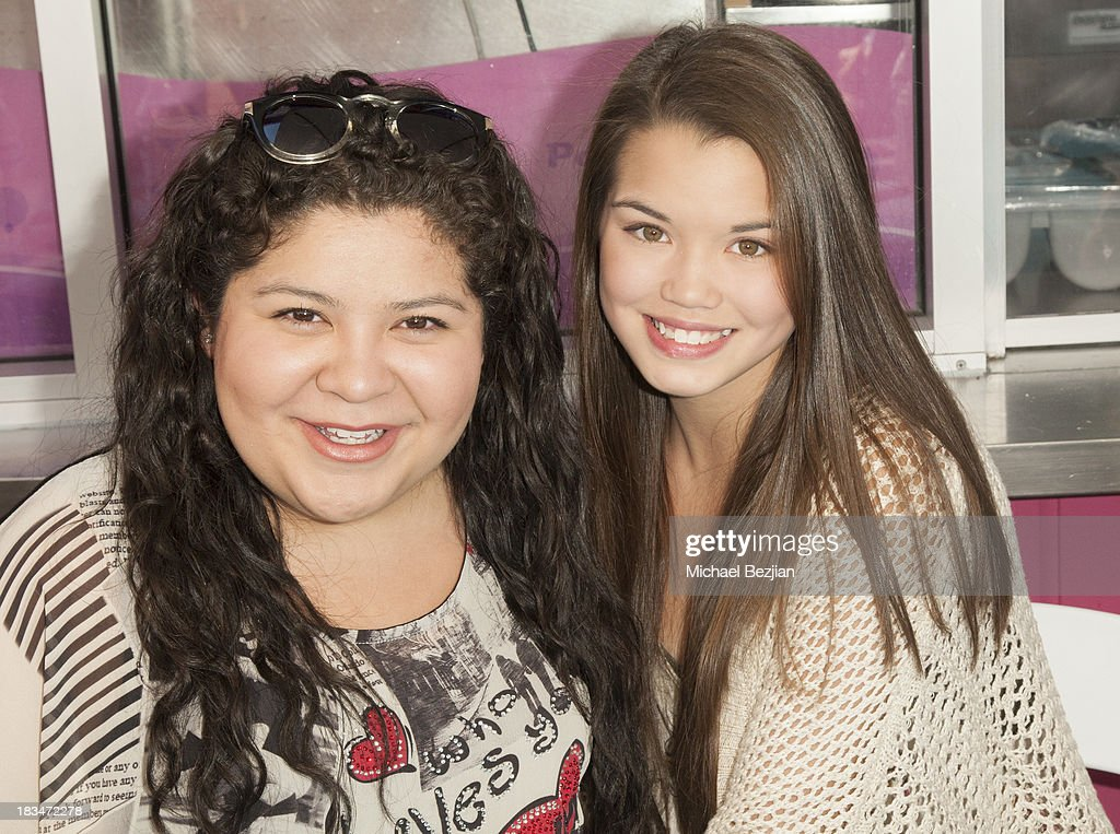 Actresses <a gi-track='captionPersonalityLinkClicked' href=/galleries/search?phrase=Raini+Rodriguez&family=editorial&specificpeople=5659055 ng-click='$event.stopPropagation()'>Raini Rodriguez</a> and Paris Berelc volunteer at the 14th Annual 'Mattel Party On The Pier' Benefiting Mattel Children's Hospital UCLA at Santa Monica Pier on October 6, 2013 in Santa Monica, California.
