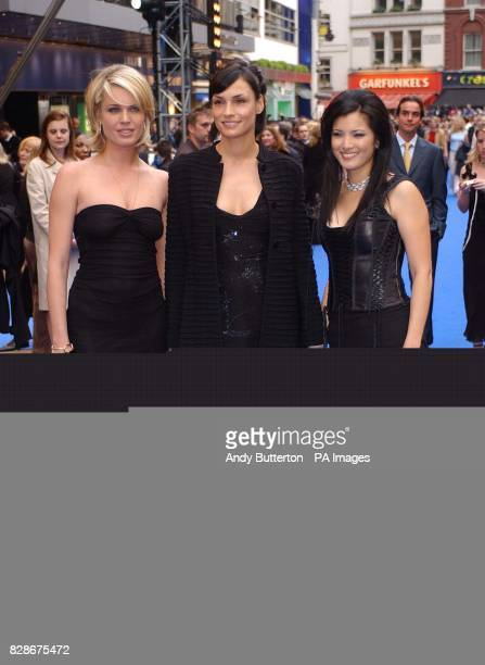 Actresses Rebecca RomijnStamos Famke Janssen and Kelly Hu arriving at the Odeon West End London for the UK premiere of XMen 2