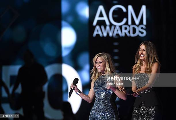 Actresses Reese Witherspoon and Sofia Vergara speak onstage during the 50th Academy of Country Music Awards at ATT Stadium on April 19 2015 in...