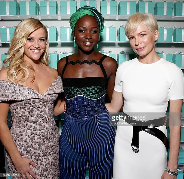 Actresses Reese Witherspoon Lupita Nyong'o and Michelle Williams attend the Vanity Fair and Tiffany Co private dinner toasting Lupita Nyong'o and...