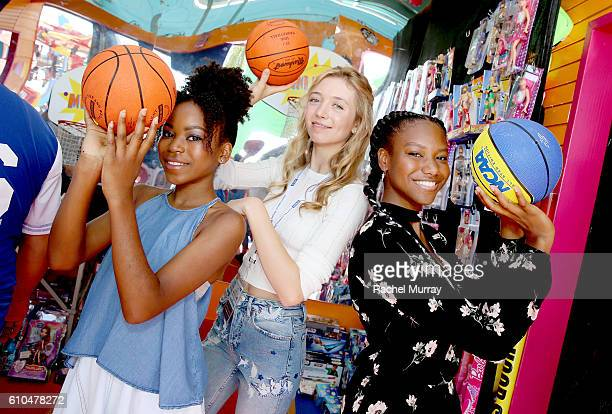Actresses Riele Downs Hana Heyes and Reiya Downs play games with guests at the Mini Hoops Booth during the 17th Annual Mattel Party on the Pier on...