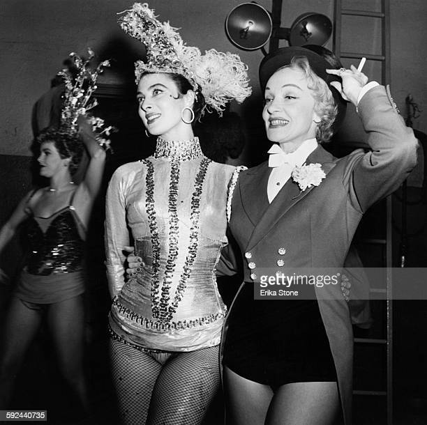 Actresses Rita Gam and Marlene Dietrich performing at the opening of a circus in New York City circa 1952