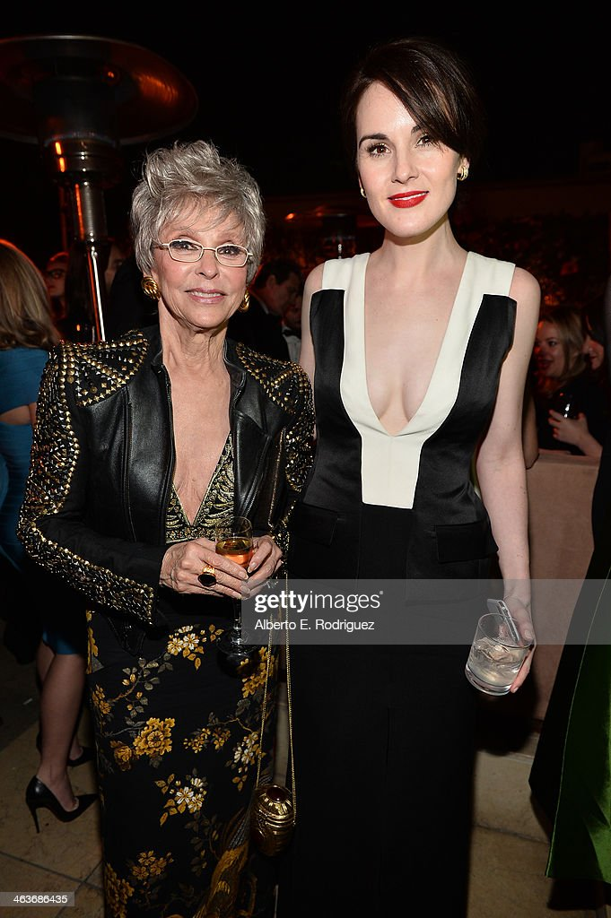 Actresses Rita Moreno (L) and Michelle Dockery attend the Weinstein Company & Netflix's 2014 SAG after party in partnership with Laura Mercier at Sunset Tower on January 18, 2014 in West Hollywood, California.