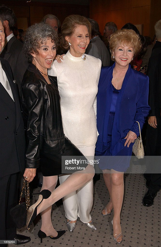 Actresses Rita Moreno, Cyd Charisse, Debbie Reynolds attend the 50th Anniversary screening of 'Singin' in the Rain' at the Academy of Motion Picture Arts and Sciences on September 5, 2002 in Beverly Hills, California.