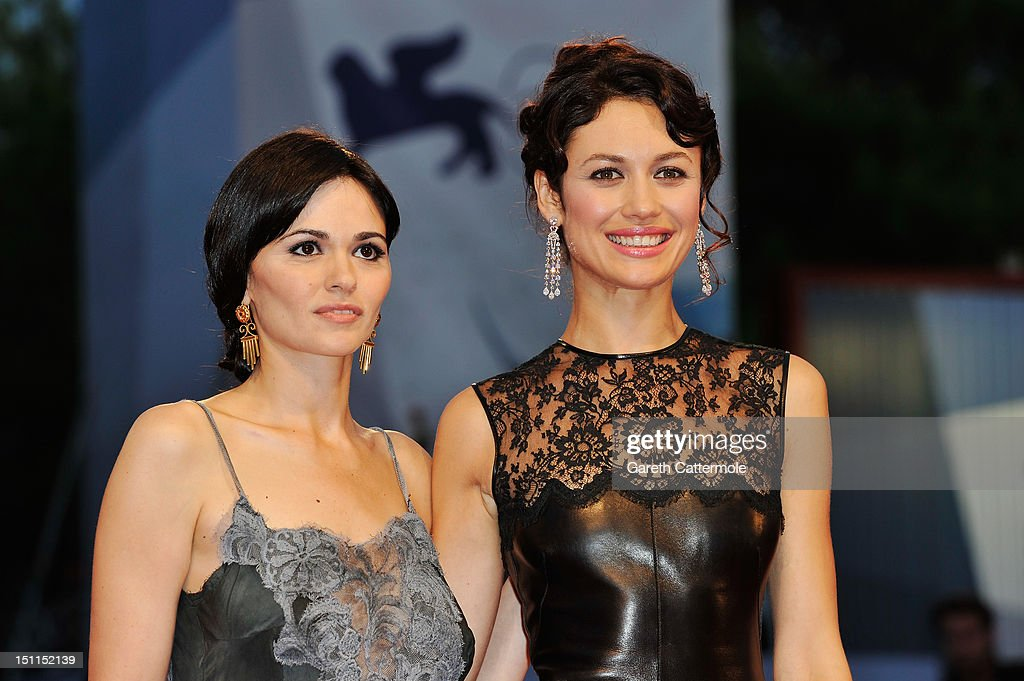 Actresses Romina Mondello (L) and Olga Kurylenko attend the 'To The Wonder' Premiere during the 69th Venice Film Festival at the Palazzo del Cinema on September 2, 2012 in Venice, Italy.