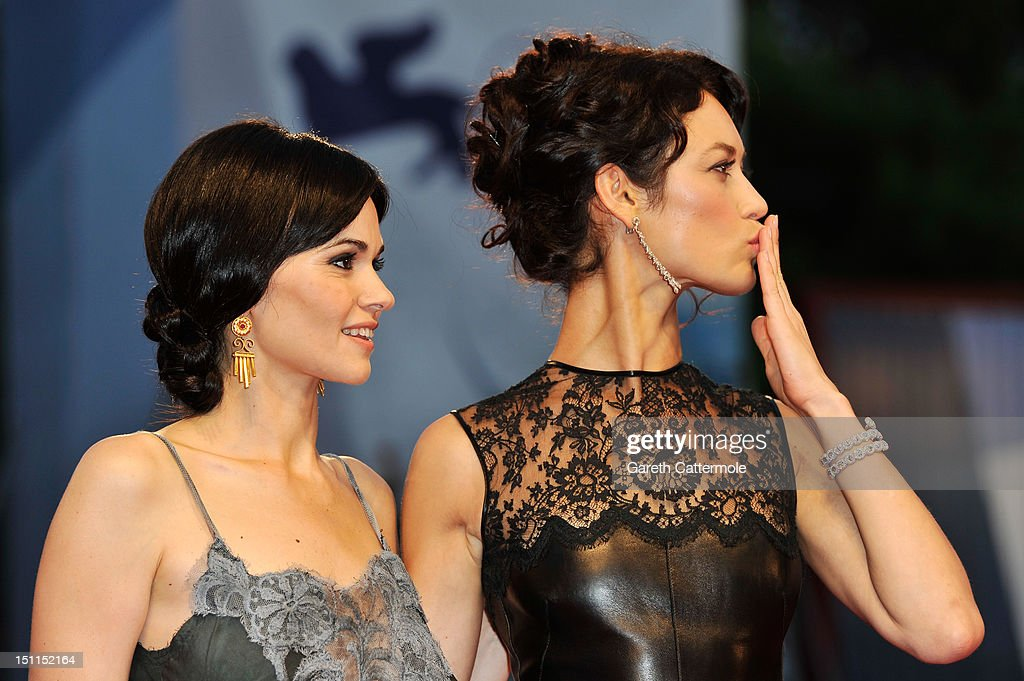 Actresses Romina Mondello (L) and <a gi-track='captionPersonalityLinkClicked' href=/galleries/search?phrase=Olga+Kurylenko&family=editorial&specificpeople=630281 ng-click='$event.stopPropagation()'>Olga Kurylenko</a> attend the 'To The Wonder' Premiere during the 69th Venice Film Festival at the Palazzo del Cinema on September 2, 2012 in Venice, Italy.