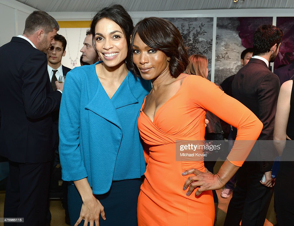 Actresses Rosario Dawson (L) and Angela Bassett, both wearing Piaget, pose in the Piaget Lounge during the 2014 Film Independent Spirit Awards at Santa Monica Beach on March 1, 2014 in Santa Monica, California.