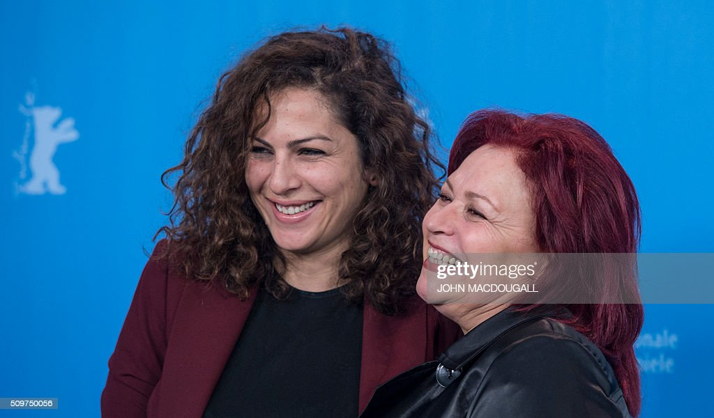 Actresses Sabah Bouzouita (R) and Rym Ben Mesaoud pose during a photocall for the Tunisian film ' Inhebbek Hedi ' ( Hedi ) during the Berlinal Film Festival in Berlin on February 12, 2016. / AFP / John MACDOUGALL