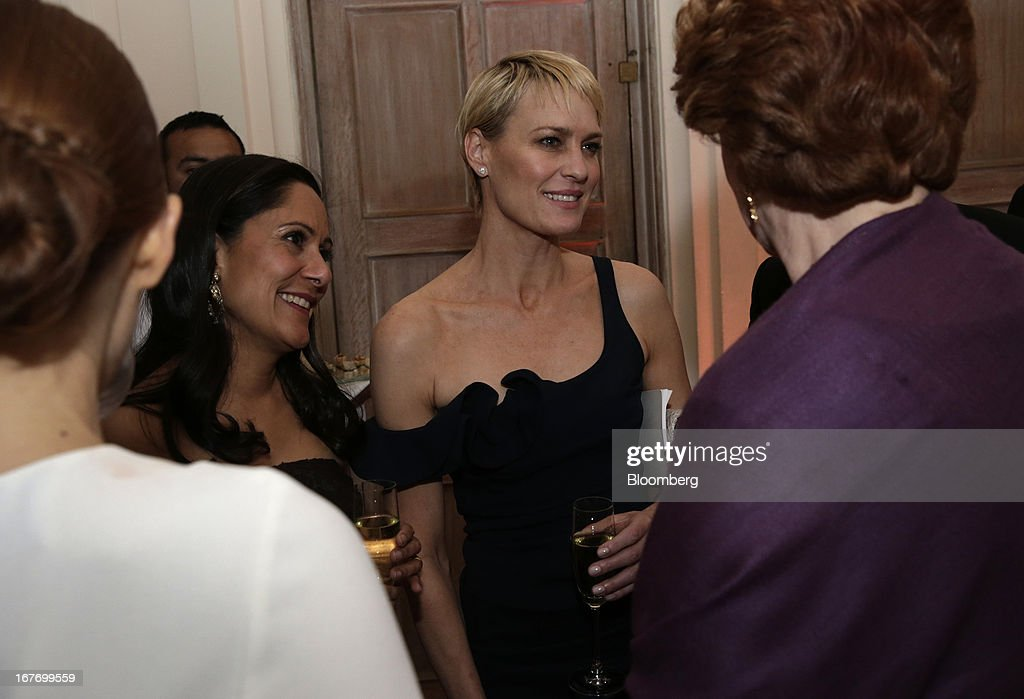 Actresses Sakina Jaffrey, left, and Robin Wright attend the Bloomberg Vanity Fair White House Correspondents' Association (WHCA) dinner afterparty in Washington, D.C., U.S., on Saturday, April 27, 2013. The 99th annual dinner raises money for WHCA scholarships and honors the recipients of the organization's journalism awards. Photographer: Scott Eells/Bloomberg via Getty Images