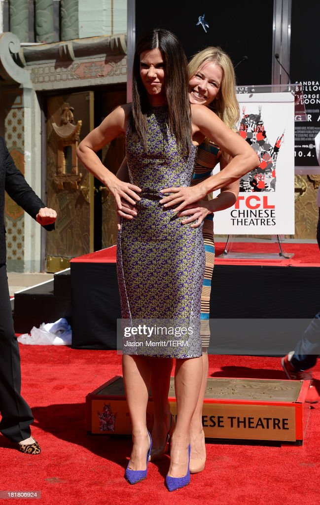 Actresses Sandra Bullock and Chelsea Handler pose for a photo as she is immortalized with a hand and footprint ceremony at TCL Chinese Theatre on September 25, 2013 in Hollywood, California.