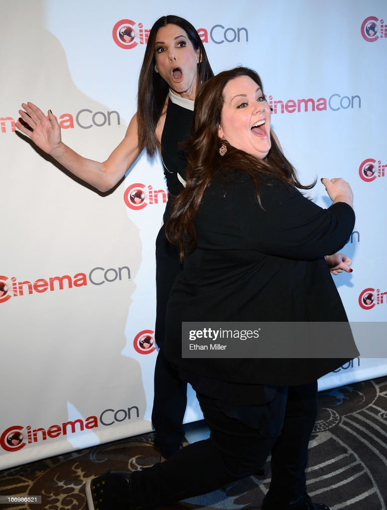Actresses Sandra Bullock (L) and Melissa McCarthy joke around as they arrive at a Twentieth Century Fox presentation to promote the upcoming film 'The Heat' at Caesars Palace during CinemaCon, the official convention of the National Association of Theatre Owners, on April 18, 2013 in Las Vegas, Nevada.