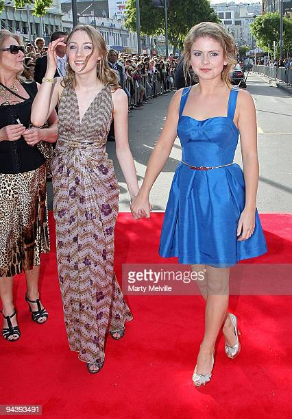 Actresses Saoirse Ronan and Rose McIver walk the red carpet during the The Lovely Bones Premiere at the Embassy Theatre on December 14 2009 in...