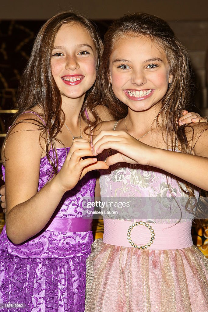 Actresses Sara Ceno (L) and Caitlin Carmichael arrive at A Country Christmas VIP screening hosted by miss Caitlin Carmichael to benefit Alex's Lemonade Stand on November 12, 2013 in Los Angeles, California.