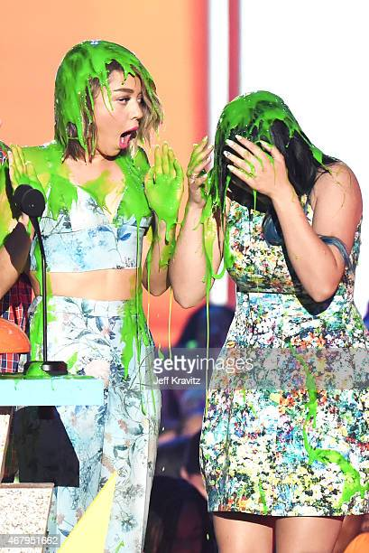 Actresses Sarah Hyland and Ariel Winter get slimed onstage during Nickelodeon's 28th Annual Kids' Choice Awards held at The Forum on March 28 2015 in...