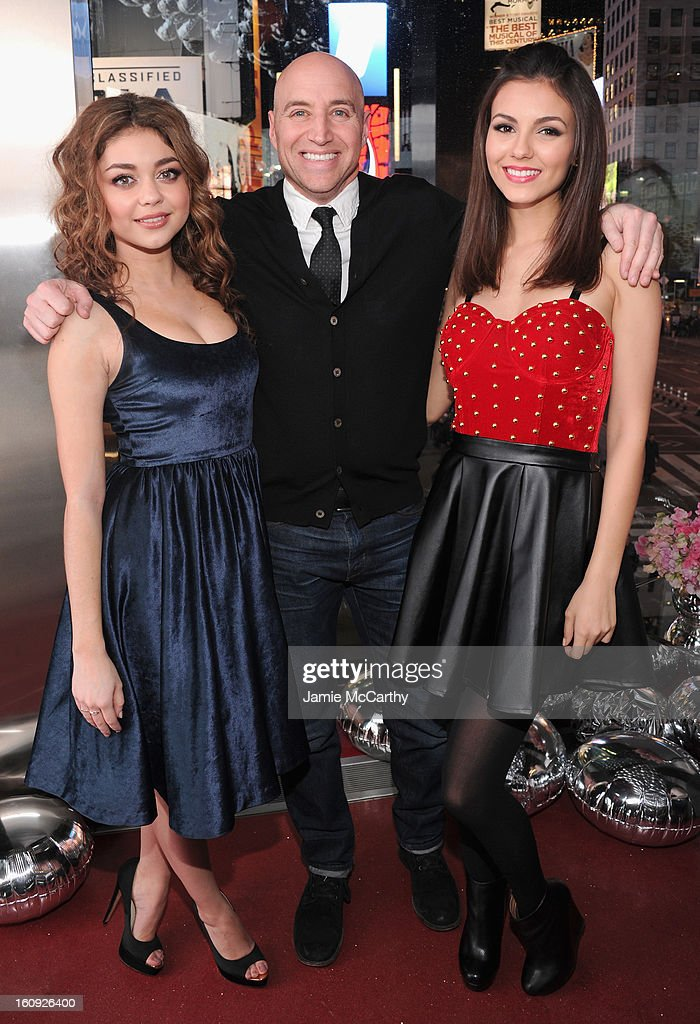 Actresses Sarah Hyland (L) and Victoria Justice (R) pose with Aeropostale Executive Scott Birnbaum at the 10th Anniversary of Teen Vogue and Aeropostale's Celebration of Chloe Grace Moretz's Sweet 16 at Aeropostale Times Square on February 7, 2013 in New York City.