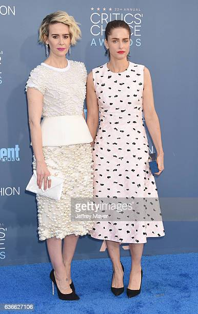 Actresses Sarah Paulson and Amanda Peet arrive at The 22nd Annual Critics' Choice Awards at Barker Hangar on December 11 2016 in Santa Monica...