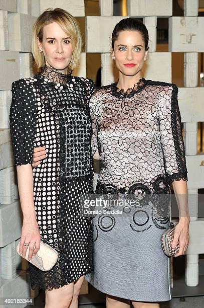 Actresses Sarah Paulson and Amanda Peet both wearing Bottega Veneta attend the Hammer Museum Gala in Garden sponsored by Bottega Veneta at Hammer...