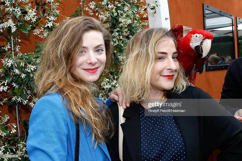Actresses Sarah Suco and <a gi-track='captionPersonalityLinkClicked' href=/galleries/search?phrase=Marilou+Berry&family=editorial&specificpeople=672535 ng-click='$event.stopPropagation()'>Marilou Berry</a> pose with parrot Arthur during Day Height of the 2016 French Tennis Open at Roland Garros on May 29, 2016 in Paris, France.