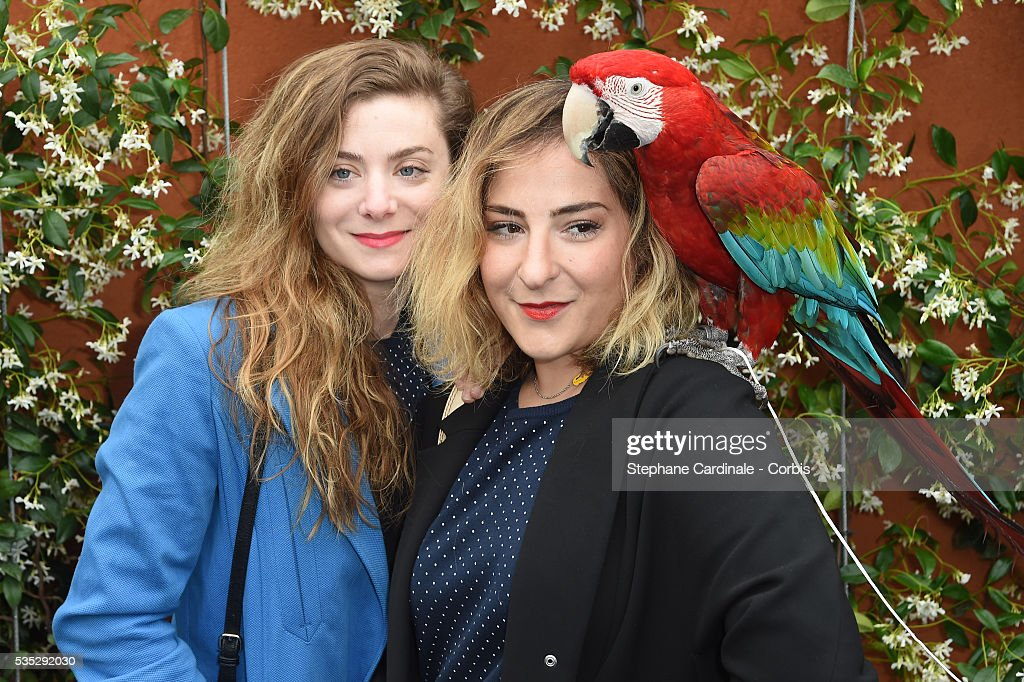 Actresses Sarah Suco and <a gi-track='captionPersonalityLinkClicked' href=/galleries/search?phrase=Marilou+Berry&family=editorial&specificpeople=672535 ng-click='$event.stopPropagation()'>Marilou Berry</a> with a parrot attend day eight of the 2016 French Open at Roland Garros on May 29, 2016 in Paris, France.