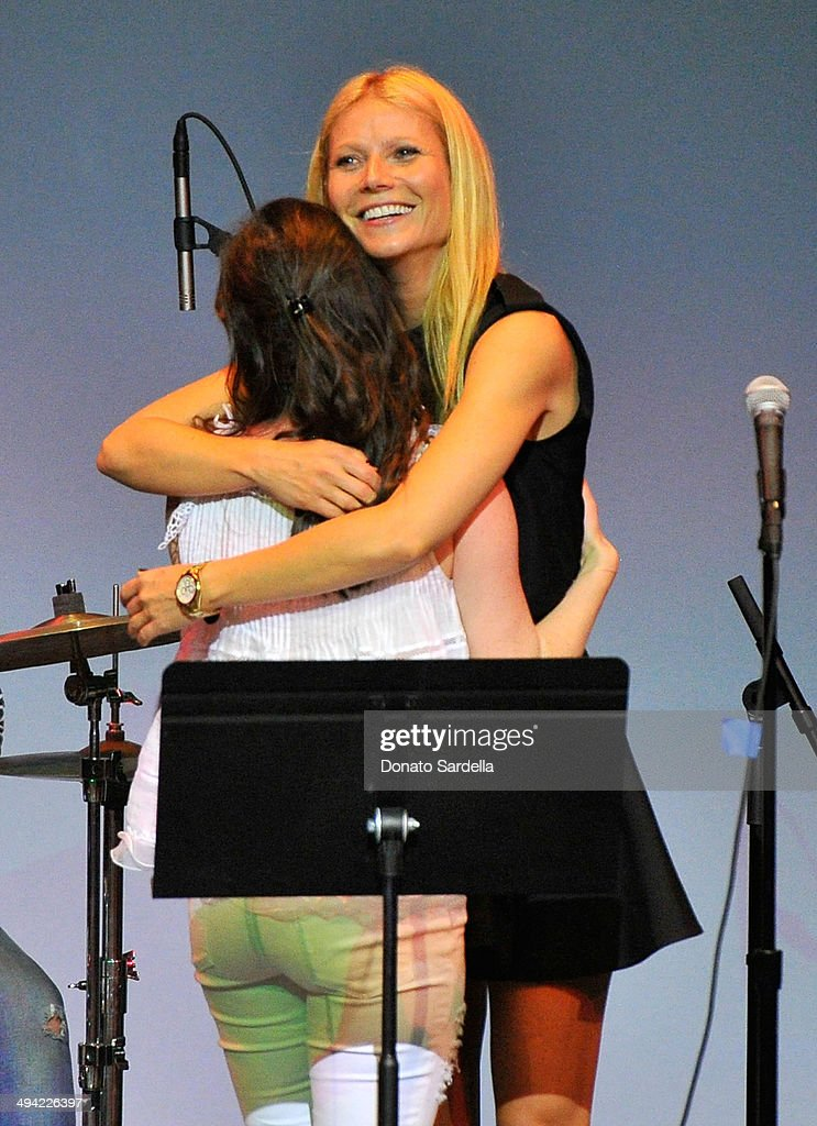 Actresses <a gi-track='captionPersonalityLinkClicked' href=/galleries/search?phrase=Sasha+Spielberg&family=editorial&specificpeople=3441139 ng-click='$event.stopPropagation()'>Sasha Spielberg</a> (L) and <a gi-track='captionPersonalityLinkClicked' href=/galleries/search?phrase=Gwyneth+Paltrow&family=editorial&specificpeople=171431 ng-click='$event.stopPropagation()'>Gwyneth Paltrow</a> perform onstage at the first annual Poetic Justice Fundraiser for the Coalition For Engaged Education at the Herb Alpert Educational Village on May 28, 2014 in Santa Monica, California.