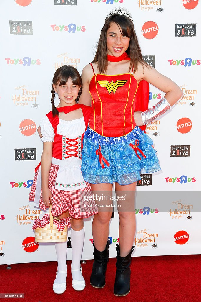 Actresses Savannah Paige Rae (L) and Emily Evan Rae attend the 2012 'Dream Halloween' presented by Keep A Child Alive at Barker Hangar on October 27, 2012 in Santa Monica, California.