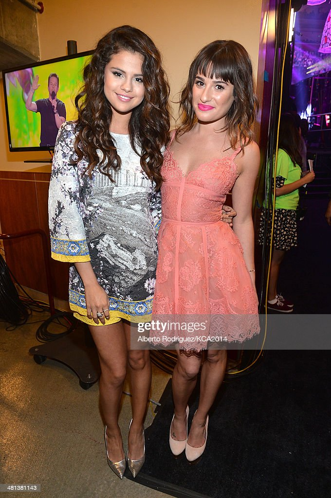 Actresses Selena Gomez (L) and Lea Michele backstage during Nickelodeon's 27th Annual Kids' Choice Awards held at USC Galen Center on March 29, 2014 in Los Angeles, California.