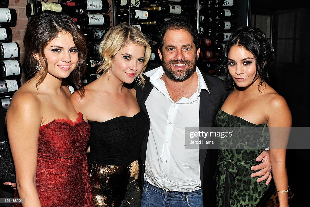 Actresses Selena Gomez, Ashley Benson, director Brett Ratner, and Vanessa Hudgens attend a dinner for the cast of 'Spring Breakers' hosted by vitaminwater during the 2012 Toronto International Film Festival at Brassaii on September 7, 2012 in Toronto, Canada.