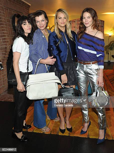 Actresses Selma Blair Milla Jovovich host/copresident Baby2Baby Kelly Sawyer Patricof and actress Michelle Monaghan attend Baby2Baby Luncheon hosted...