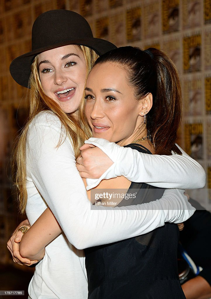 Actresses <a gi-track='captionPersonalityLinkClicked' href=/galleries/search?phrase=Shailene+Woodley&family=editorial&specificpeople=676833 ng-click='$event.stopPropagation()'>Shailene Woodley</a> (L) and <a gi-track='captionPersonalityLinkClicked' href=/galleries/search?phrase=Maggie+Q&family=editorial&specificpeople=555127 ng-click='$event.stopPropagation()'>Maggie Q</a> attend the 'Ender's Game' and 'Divergent' press line during Comic-Con International 2013 at the Hilton San Diego Bayfront Hotel on July 18, 2013 in San Diego, California.