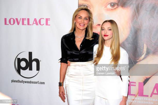 Actresses Sharon Stone and Amanda Seyfried arrive at the Las Vegas premiere of the movie 'Lovelace' at Planet Hollywood Resort Casino on August 4...