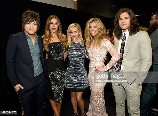Actresses Sofia Vergara and Reese Witherspoon pose with members of The Band Perry Neil Perry Kimberly Perry and Reid Perry backstage at the 50th...