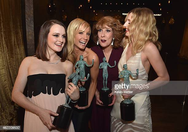 Actresses Sophie McShera Joanne Froggatt Phyllis Logan and Laura Carmichael pose in the trophy room at TNT's 21st Annual Screen Actors Guild Awards...