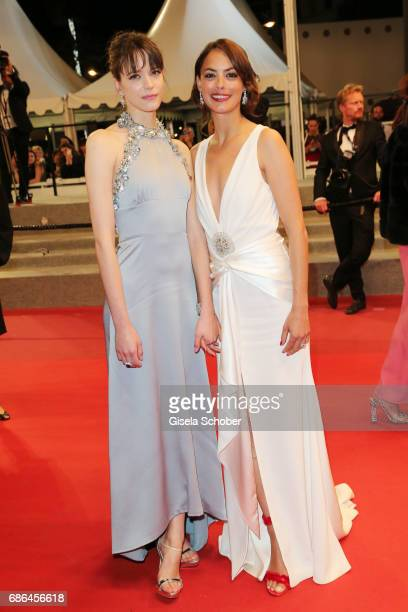 Actresses Stacy Martin and Berenice Bejo depart after the 'Redoubtable ' screening during the 70th annual Cannes Film Festival at Palais des...