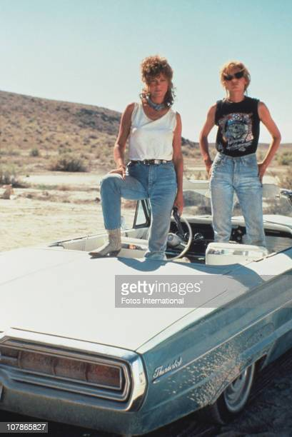 Actresses Susan Sarandon and Geena Davis pose on their 1966 Ford Thunderbird for the film 'Thelma And Louise' 1991
