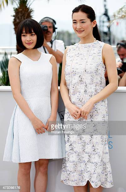 Actresses Suzu Hirose and Haruka Ayase attend a photocall for 'Umimachi Diary' during the 68th annual Cannes Film Festival on May 14 2015 in Cannes...