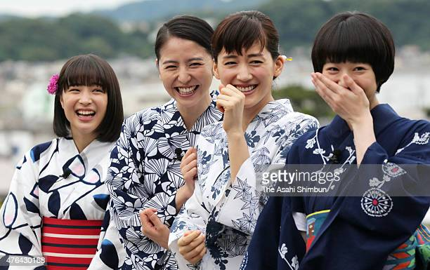 Actresses Suzu Hirose Masami Nagasawa Haruka Ayase and Kaho wearing yukata Japanese summer kimono pose for photographs during the 'Umimachi Diary '...