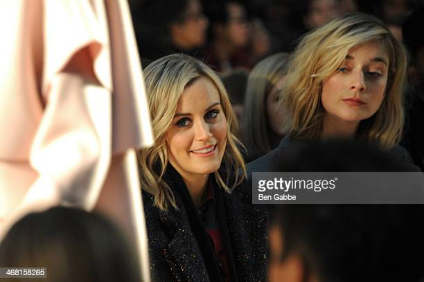 Actresses Taylor Schilling and Caitlin Fitzgerald attend the Thakoon fashion show during MercedesBenz Fashion Week Fall 2014 on February 9 2014 in...