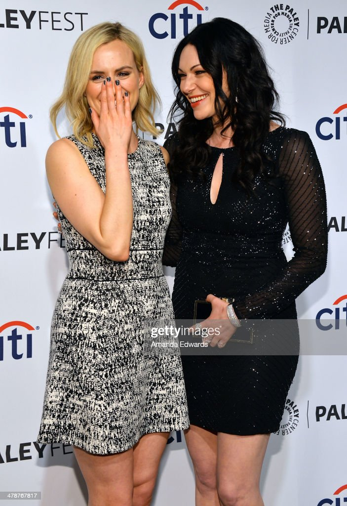 Actresses <a gi-track='captionPersonalityLinkClicked' href=/galleries/search?phrase=Taylor+Schilling&family=editorial&specificpeople=5852086 ng-click='$event.stopPropagation()'>Taylor Schilling</a> (L) and <a gi-track='captionPersonalityLinkClicked' href=/galleries/search?phrase=Laura+Prepon&family=editorial&specificpeople=211299 ng-click='$event.stopPropagation()'>Laura Prepon</a> arrive at the 2014 PaleyFest - 'Orange Is The New Black' event at the Dolby Theatre on March 14, 2014 in Hollywood, California.
