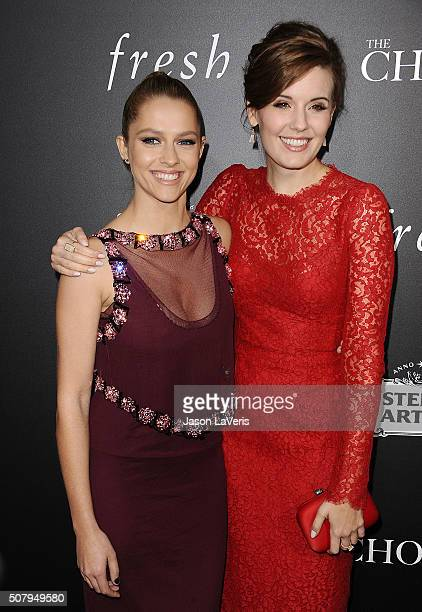 Actresses Teresa Palmer and Maggie Grace attend the premiere of 'The Choice' at ArcLight Cinemas on February 1 2016 in Hollywood California