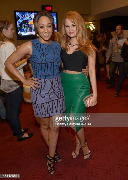 Actresses Tia Mowry and Debby Ryan attend Nickelodeon's 27th Annual Kids' Choice Awards held at USC Galen Center on March 29 2014 in Los Angeles...