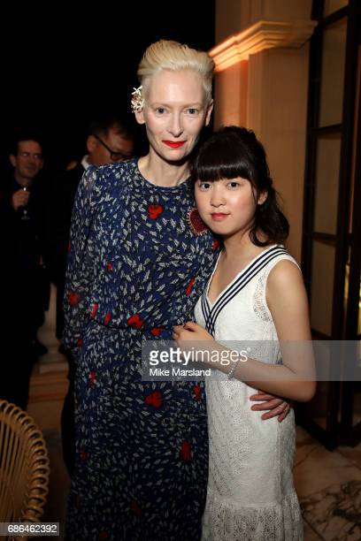 Actresses Tilda Swinton and Ahn SeoHyun attend the Netflix party during the 70th annual Cannes Film Festival at on May 21 2017 in Cannes France