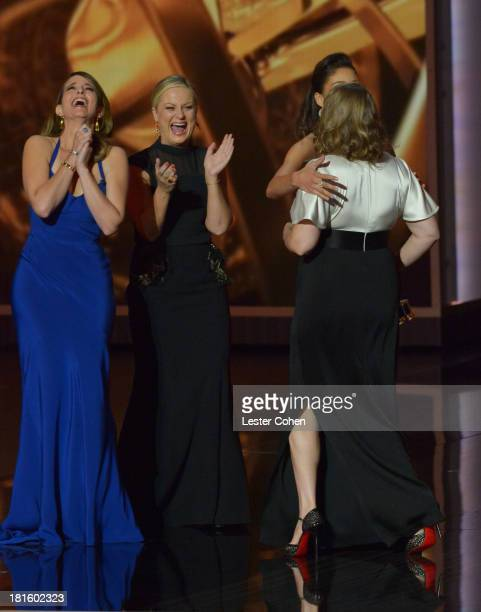 Actresses Tina Fey Amy Poehler and Merrit Wever appear onstage during the 65th Annual Primetime Emmy Awards held at Nokia Theatre LA Live on...