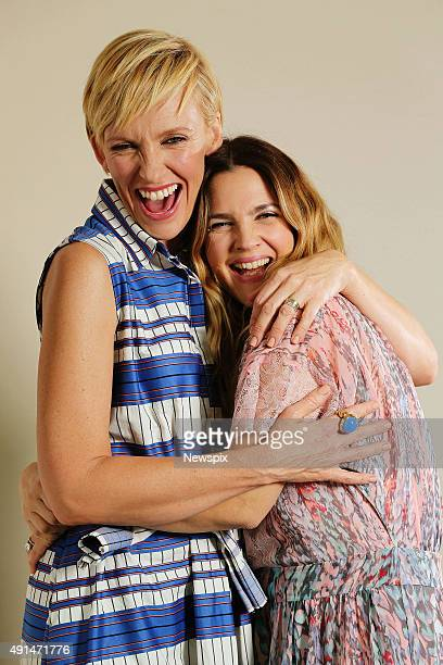 Actresses Toni Collette and Drew Barrymore pose during a photo shoot in Sydney New South Wales to promote their film 'Miss You Already'