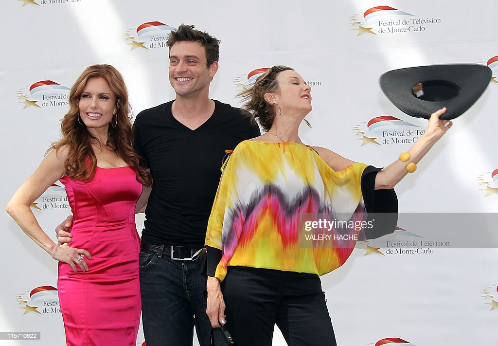 US actresses Tracey Bregman (L) and Judith Chapman pose with Australian actor Daniel Goddard (C) during a photocall for the TV show 'The young and the restless' as part of the 2011 Monte Carlo Television Festival held at the Grimaldi Forum on June 9, 2011 in Monte-Carlo, Monaco. The Monte Carlo Television Festival held since 1961, aims at encouraging the new art form of television.