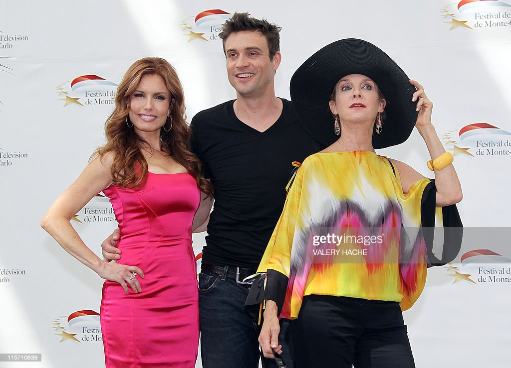 US actresses Tracey Bregman (L) and Judith Chapman pose with Australian actor Daniel Goddard (C) during a photocall for the TV show 'The young and the restless' as part of the 2011 Monte Carlo Television Festival held at the Grimaldi Forum on June 9, 2011 in Monte-Carlo, Monaco. The Monte Carlo Television Festival held since 1961, aims at encouraging the new art form of television. AFP PHOTO VALERY HACHE